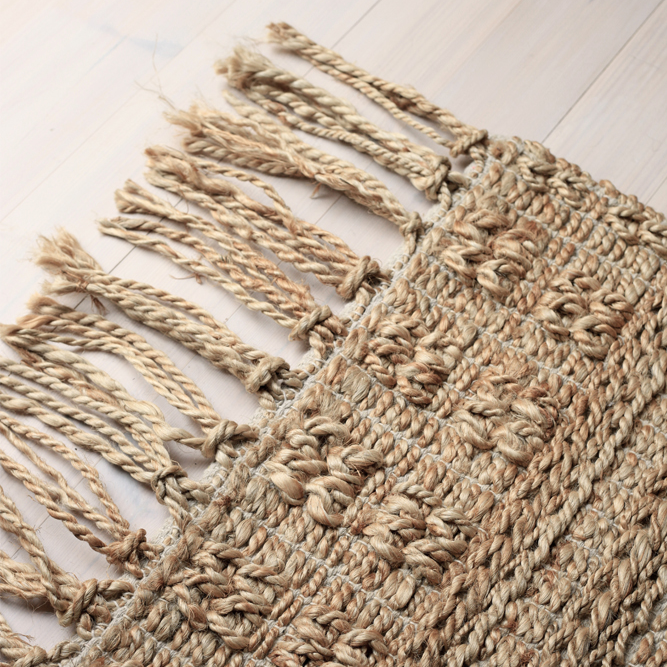 close up of wicker rug by Roots Living